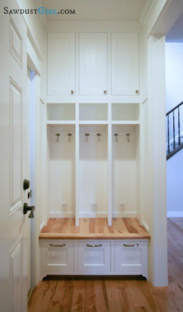 -  Maximize space: a mudroom tucked next to the front door with cabinets from floor to ceiling.