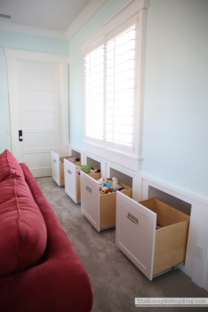 This homeowner used empty space behind the walls and under her window to have pull-out drawers installed. When closed, they sit flush with the wall. It offers up a storage solution (she uses her for her kids toys) in a way that is genius and taps into otherwise unusable space! If you have a place in your home like this, consider having some pull-out drawers installed. It's a pretty smart solution!