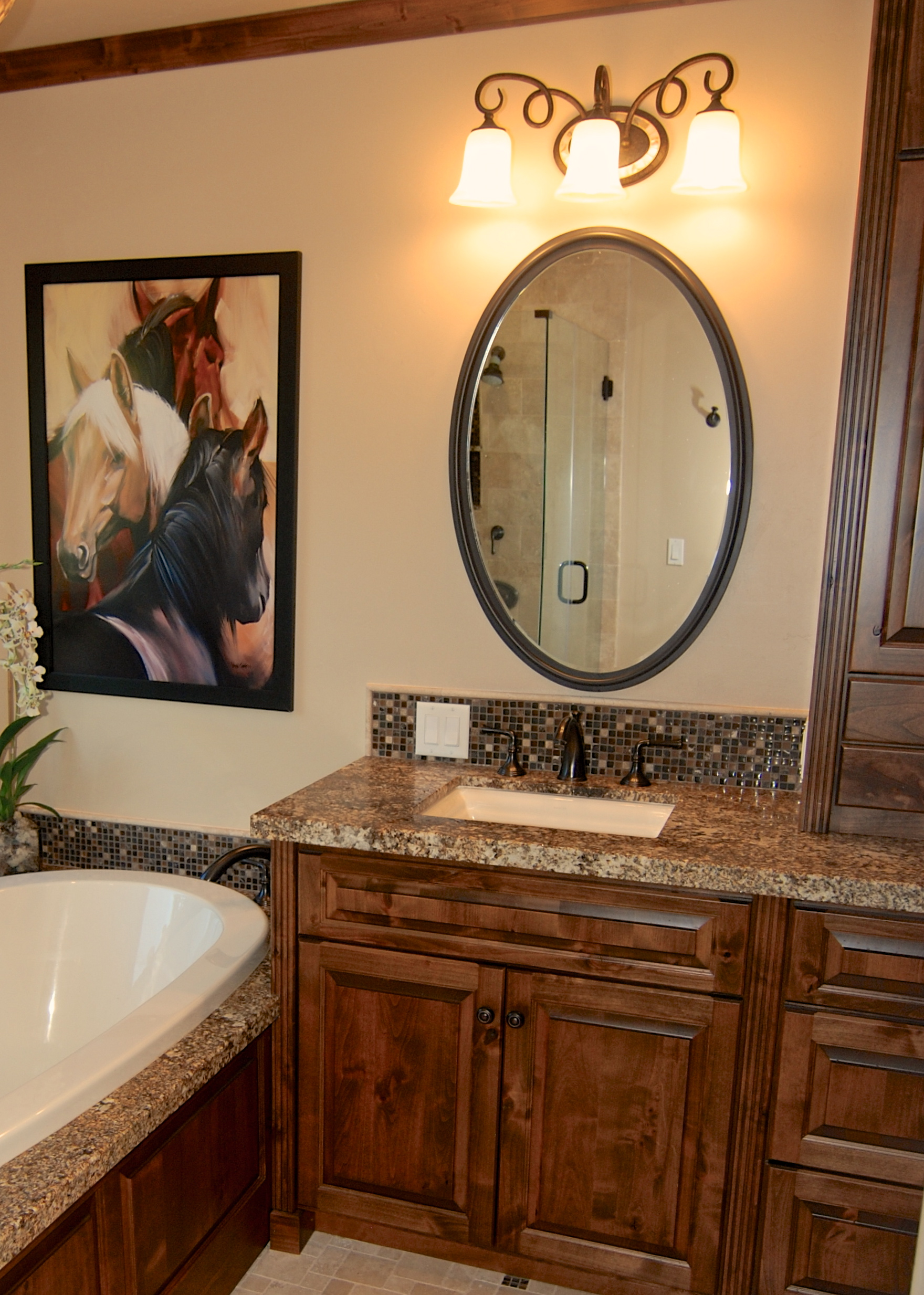 natural wood vanity and oval mirror