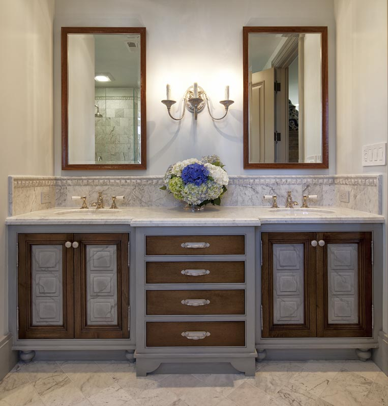 marble bathroom floor and candlestick sconce