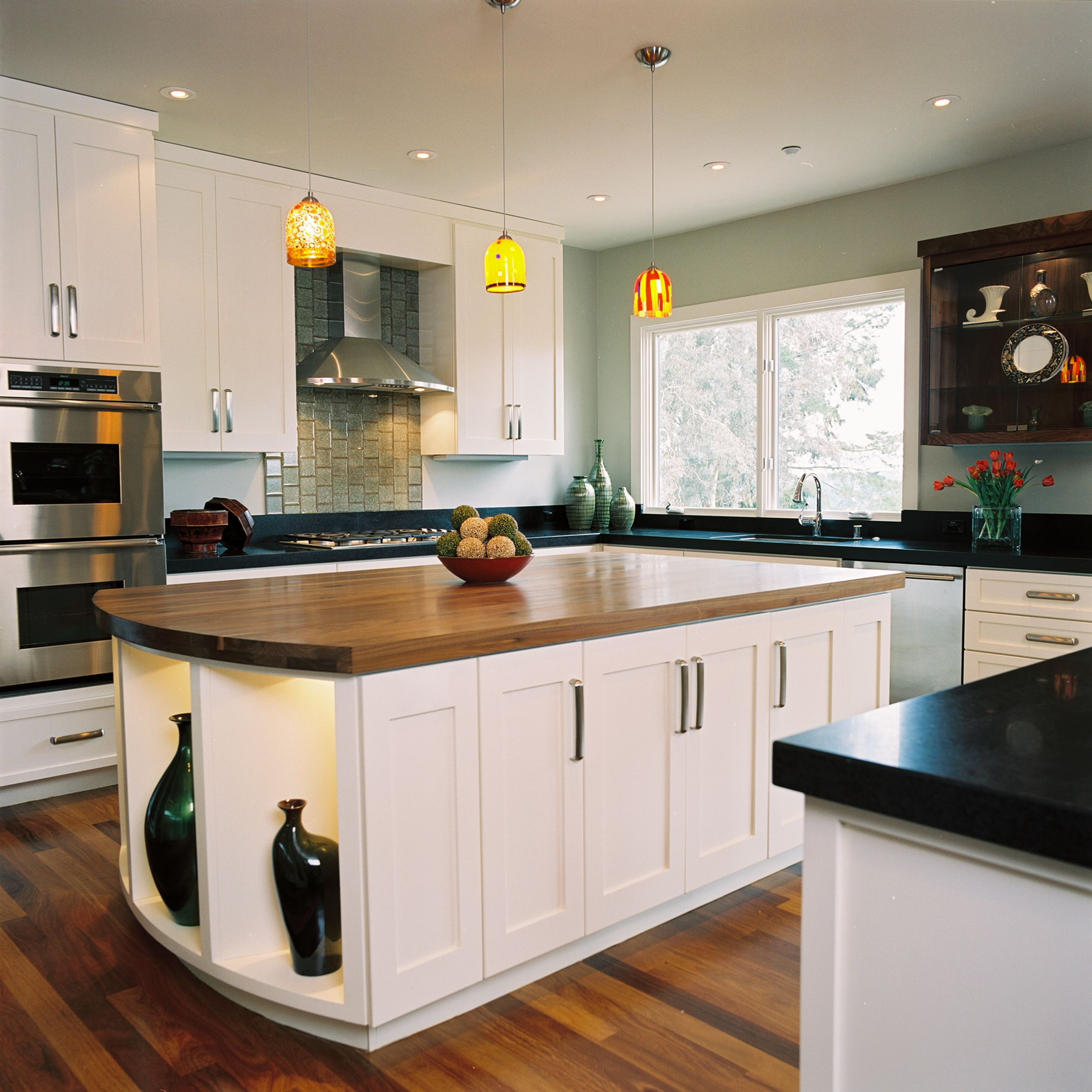 accent shelving in island and stainless steel appliances