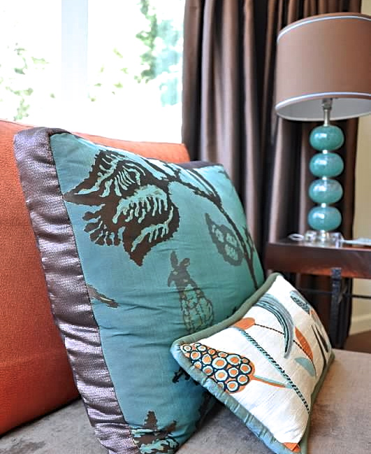 Master throw pillows and accent table