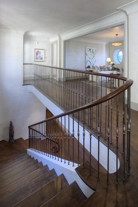 Pebble Beach stair landing custom railing
