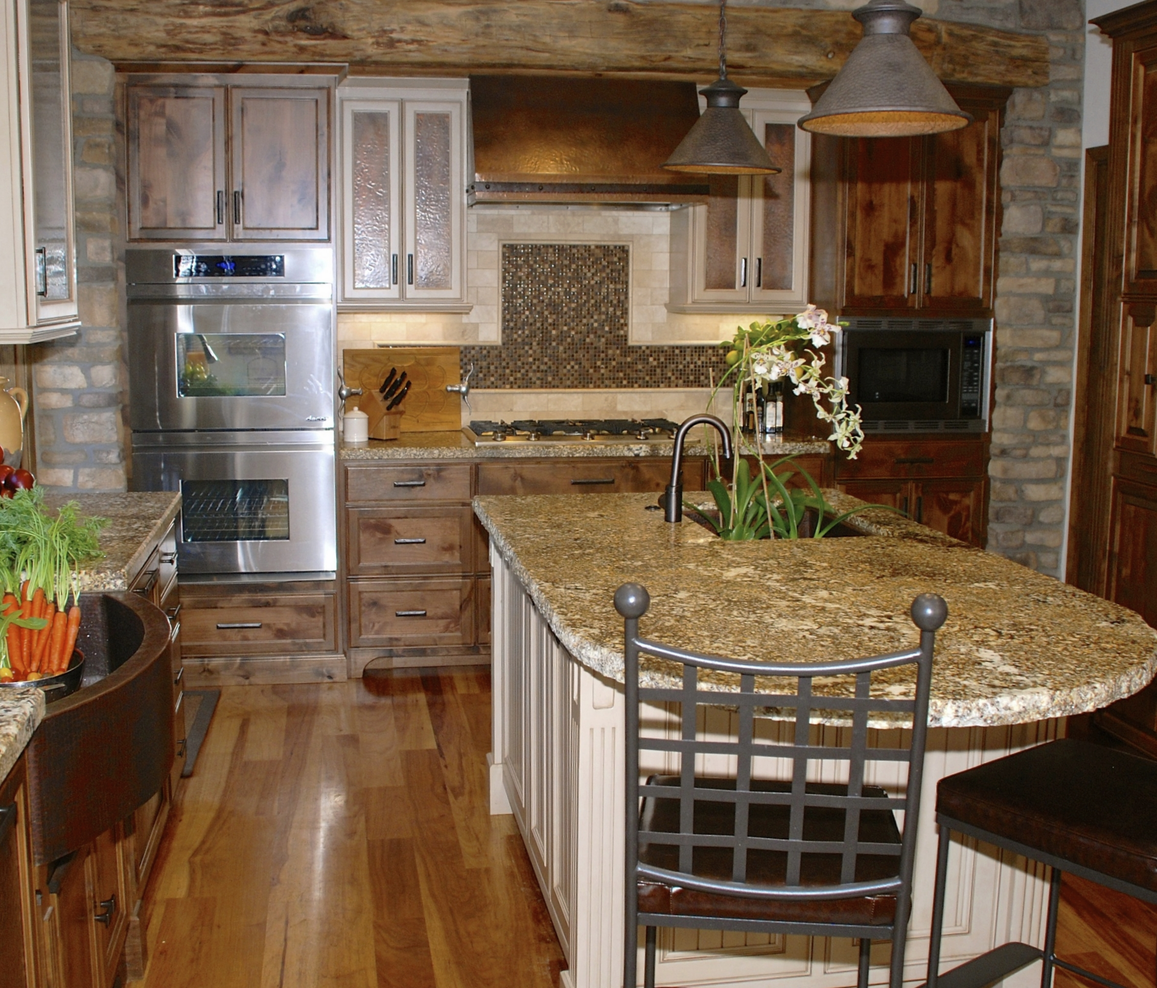 wood floor and stone wall kitchen