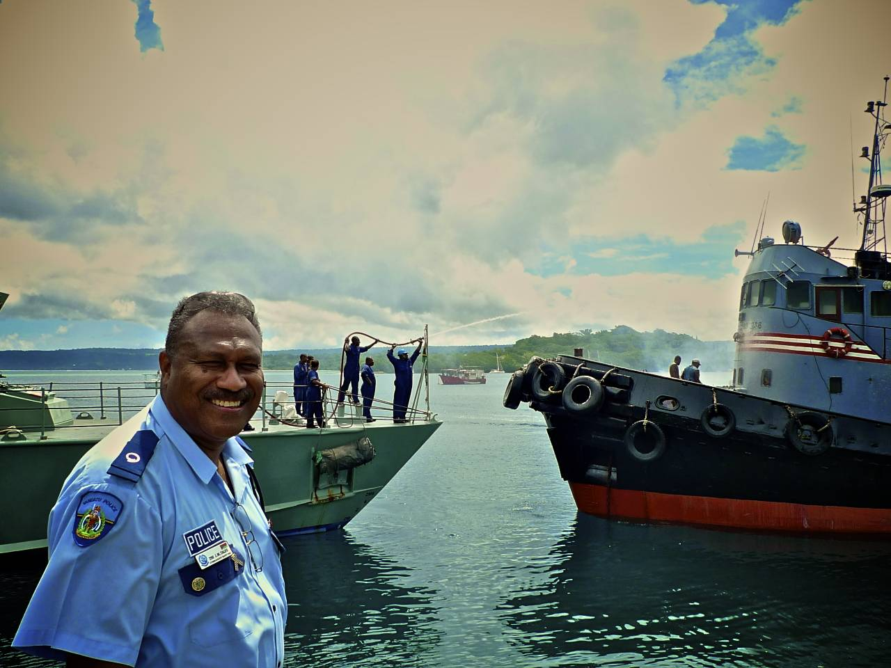 head of the maritime police (and head of surveillance of fisheries operation as well) taking control on the situation... behind the patrol boat crew helping (and giving the crew of the boat in problem a shower).jpg