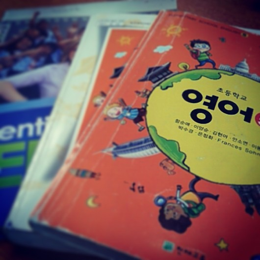 The textbook and teacher guide for 5th grade and my trusty  Essential TEFL