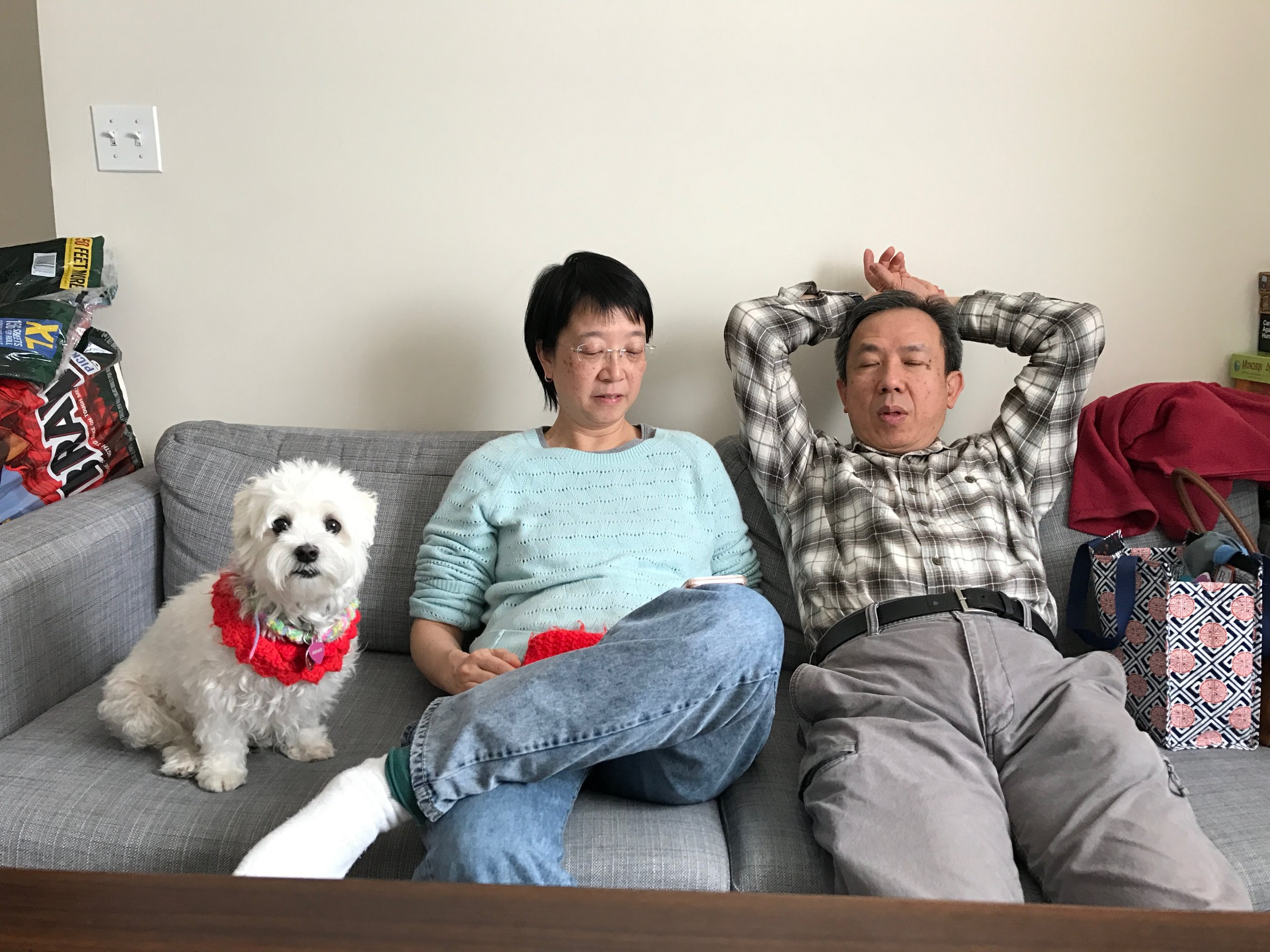 Mom Dad and Momo at the apartment chilling