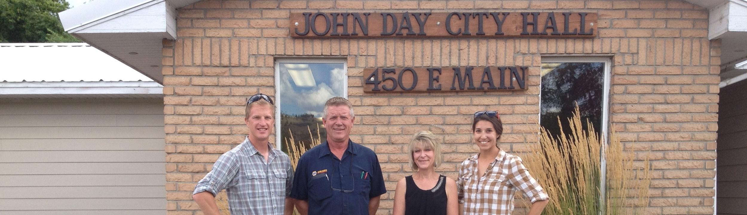 Adam and Ashley with Mayor Ron Lundbom and City Manager Peggy Gray, July 2014