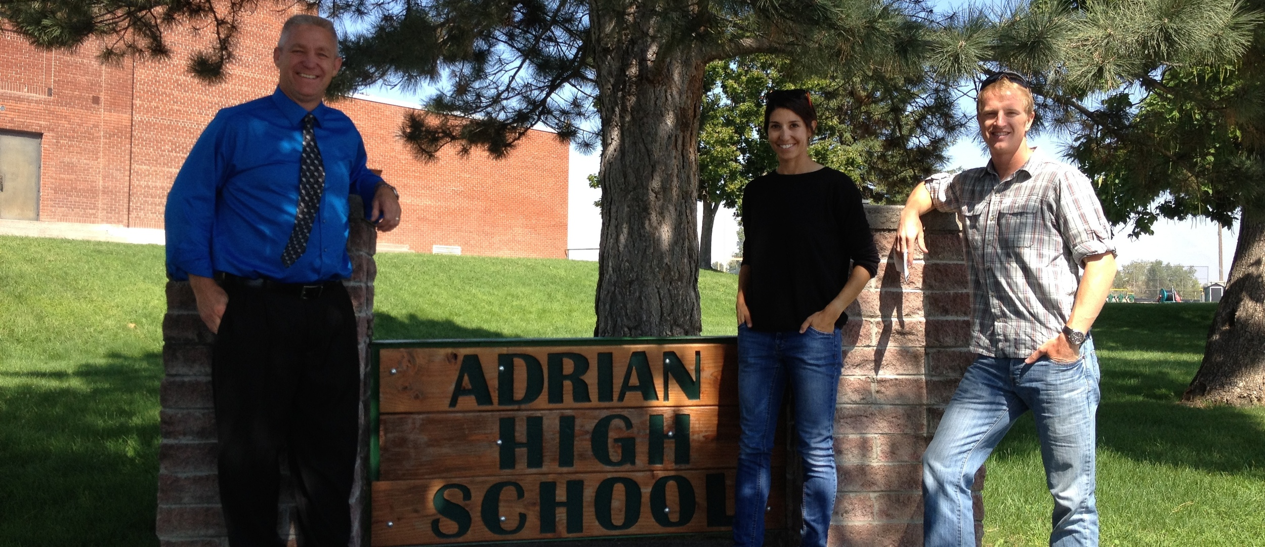Adam and Ashley with Adrian High School Principal Purnell, July 2014