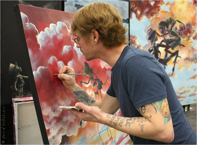 Lehman painting as a featured artist at Indiana Artisan Marketplace. Photo by David Hutchison.