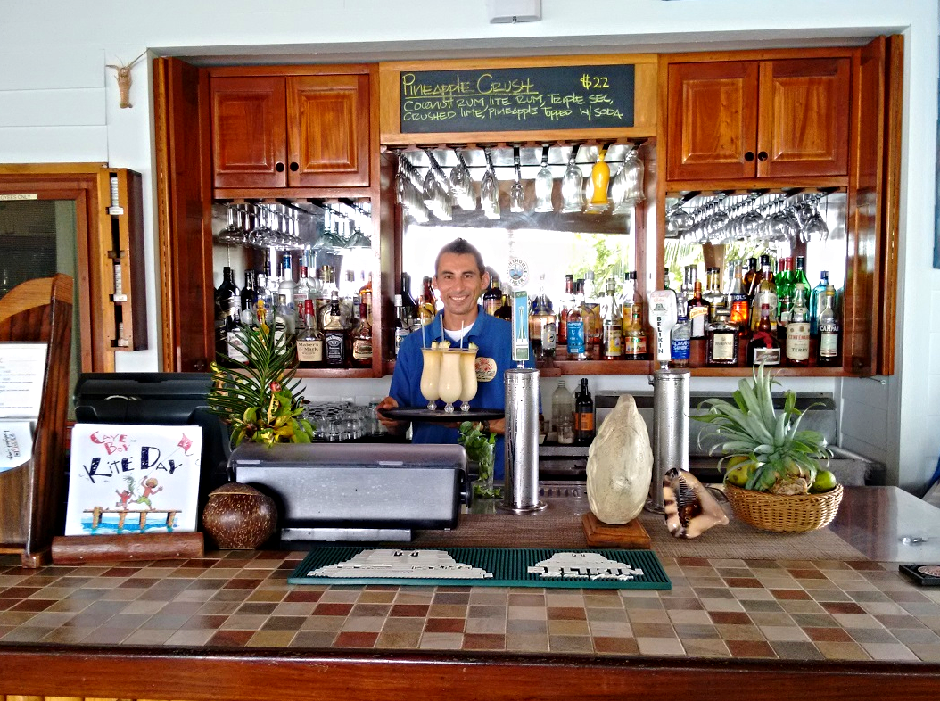 Antonio serving up piña coladas at the Lionfish Grill on Hatchet Caye
