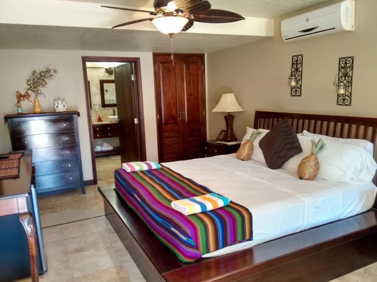 the comfortable king rooms at Caribbean Shores B&B