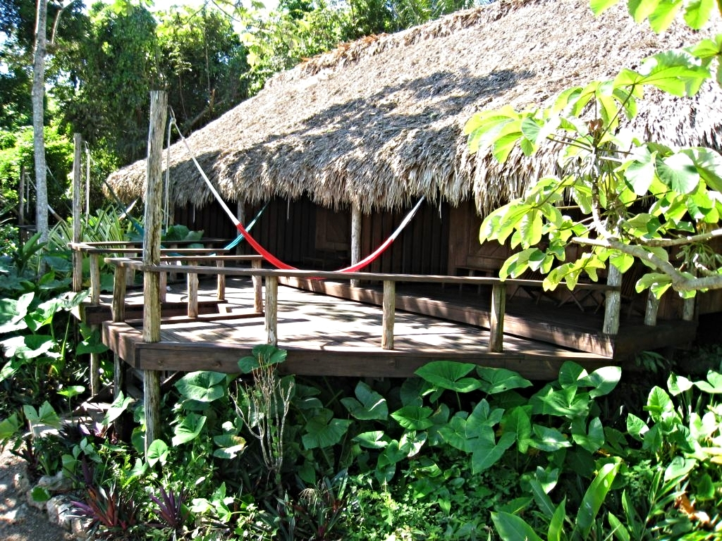 the cabanas at the lamanai Outpost Lodge