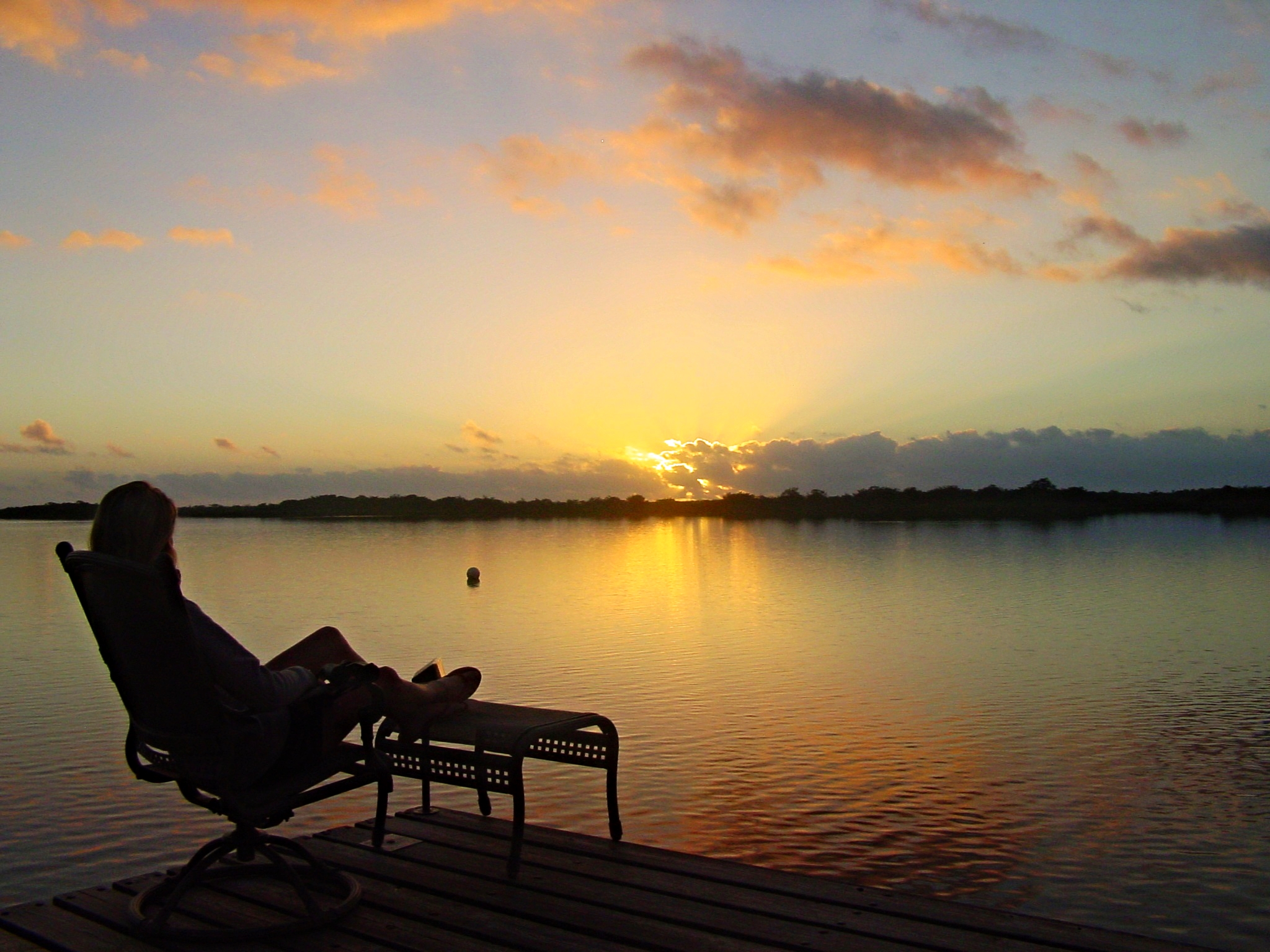 Dawn over the lagoon at the Lamanai Outpost Lodge