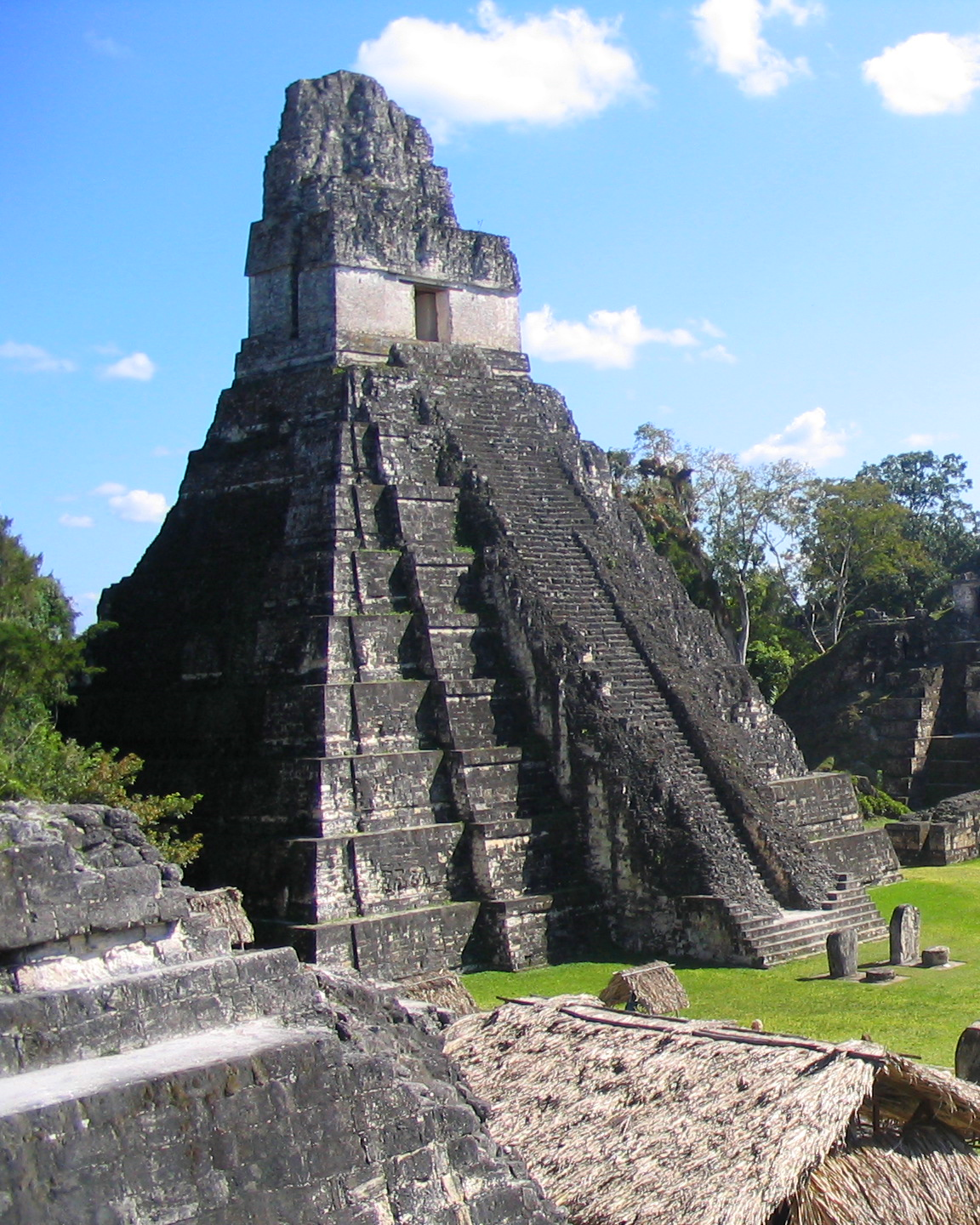 The Temple of the Great Jaguar, also known as Temple One, towers above the Central Acropolis at Tikal.