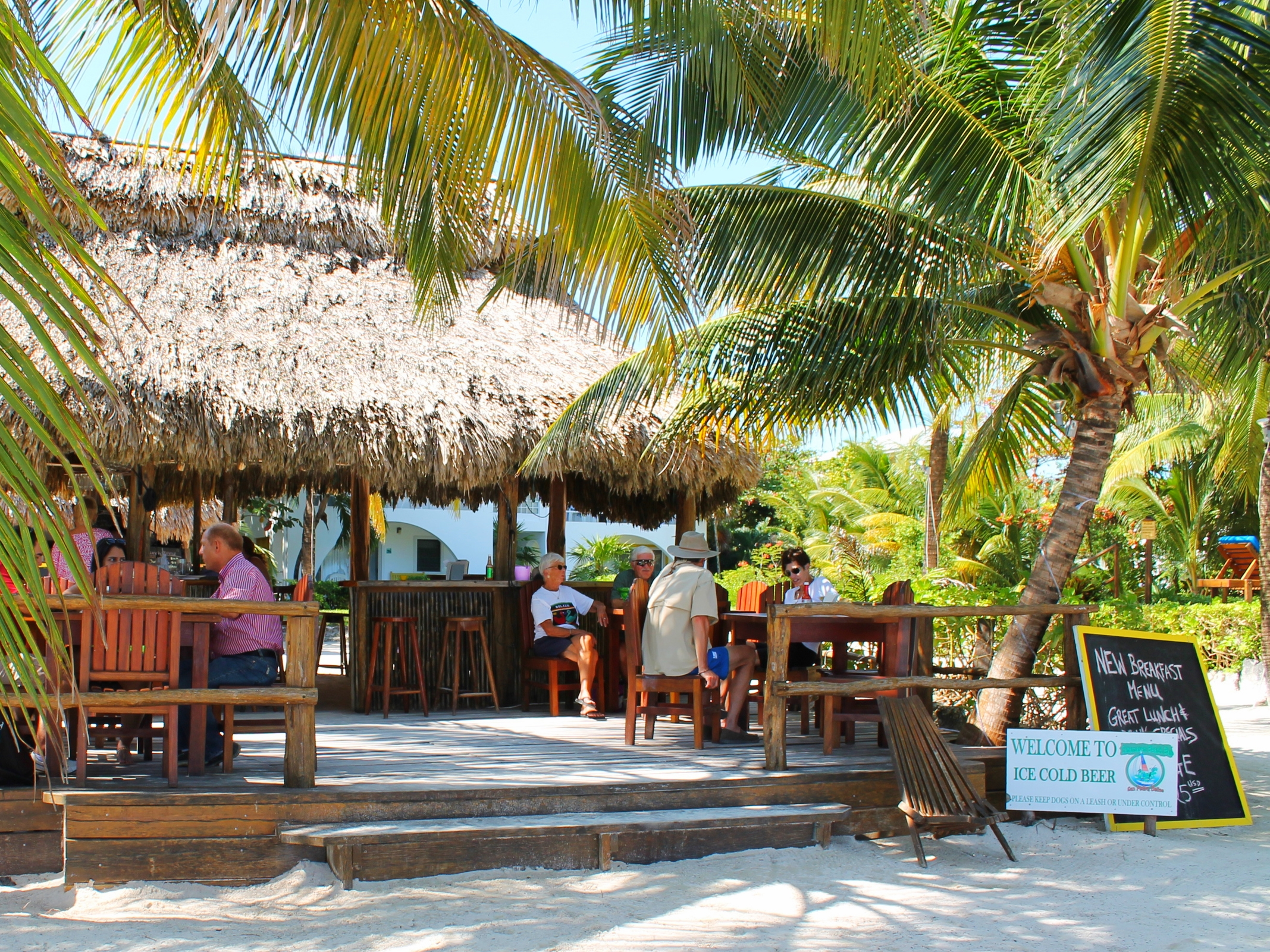 Pausing for a cold Belikin in a friendly place is a must on Ambergris Caye