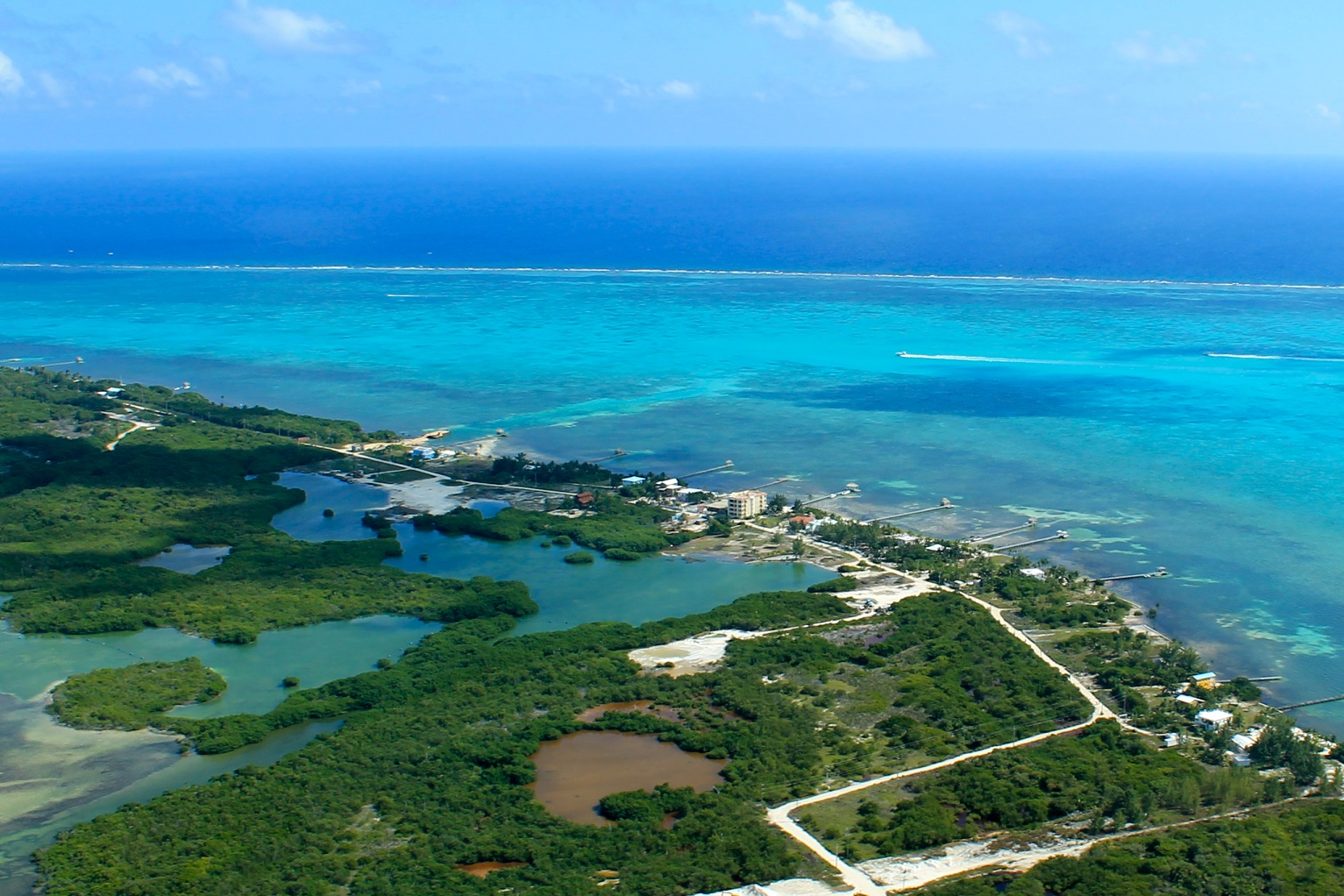 Belize's barrier reef runs right in front on Ambergris Caye