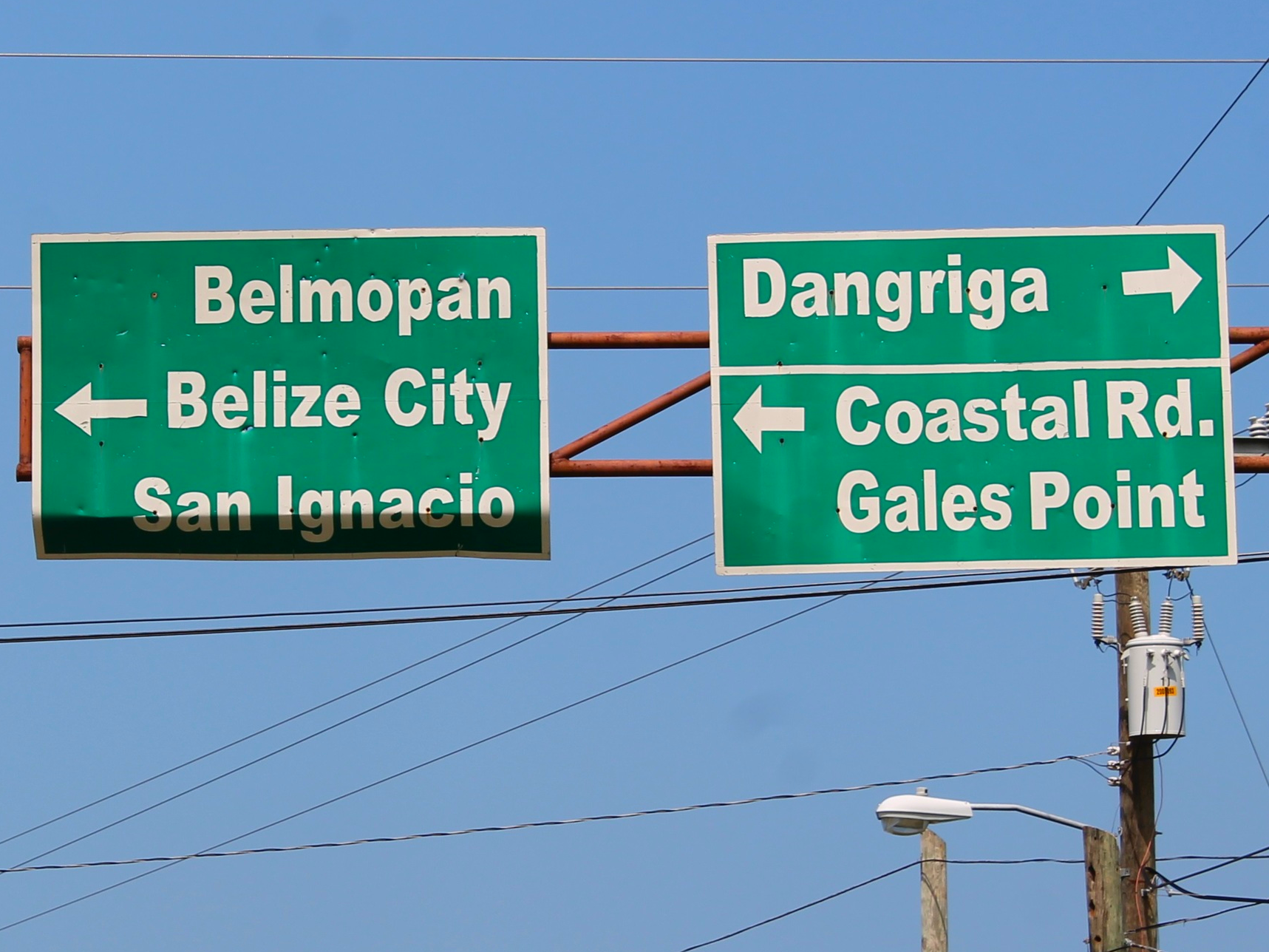 Every major highway intersection is marked by signs like these