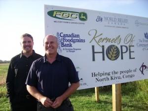 Kendall Arndt and Ray Baloun at Melfort, SK field, 2011.