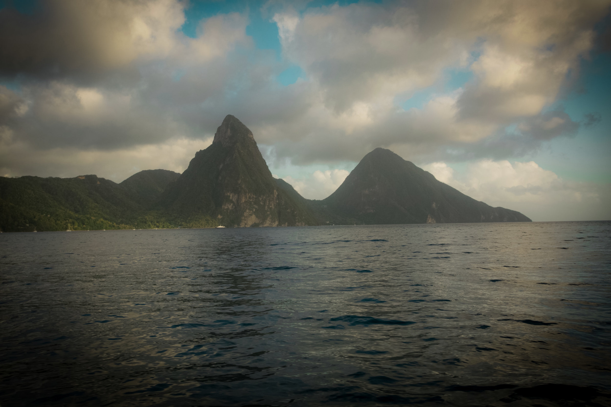 The famous grandeur Pitons on the island of St. Lucia , The Gros Piton is 771 m high, and the Petit Piton is 743 m high and always intoxicating to look at. Photography Courtesy of The Aisle Photography