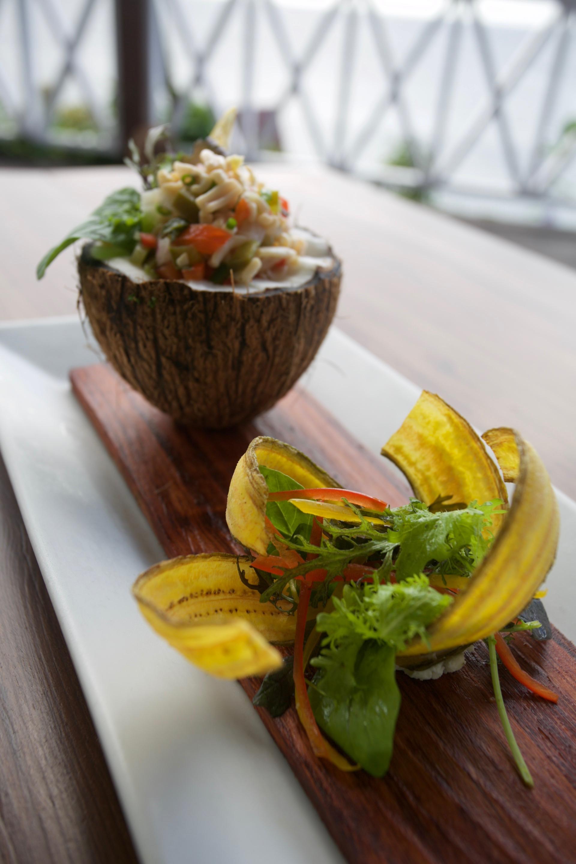 Calamari Coconut Ceviche  Kai Manje Restaurant  Photography Courtesy of The Aisle Photography