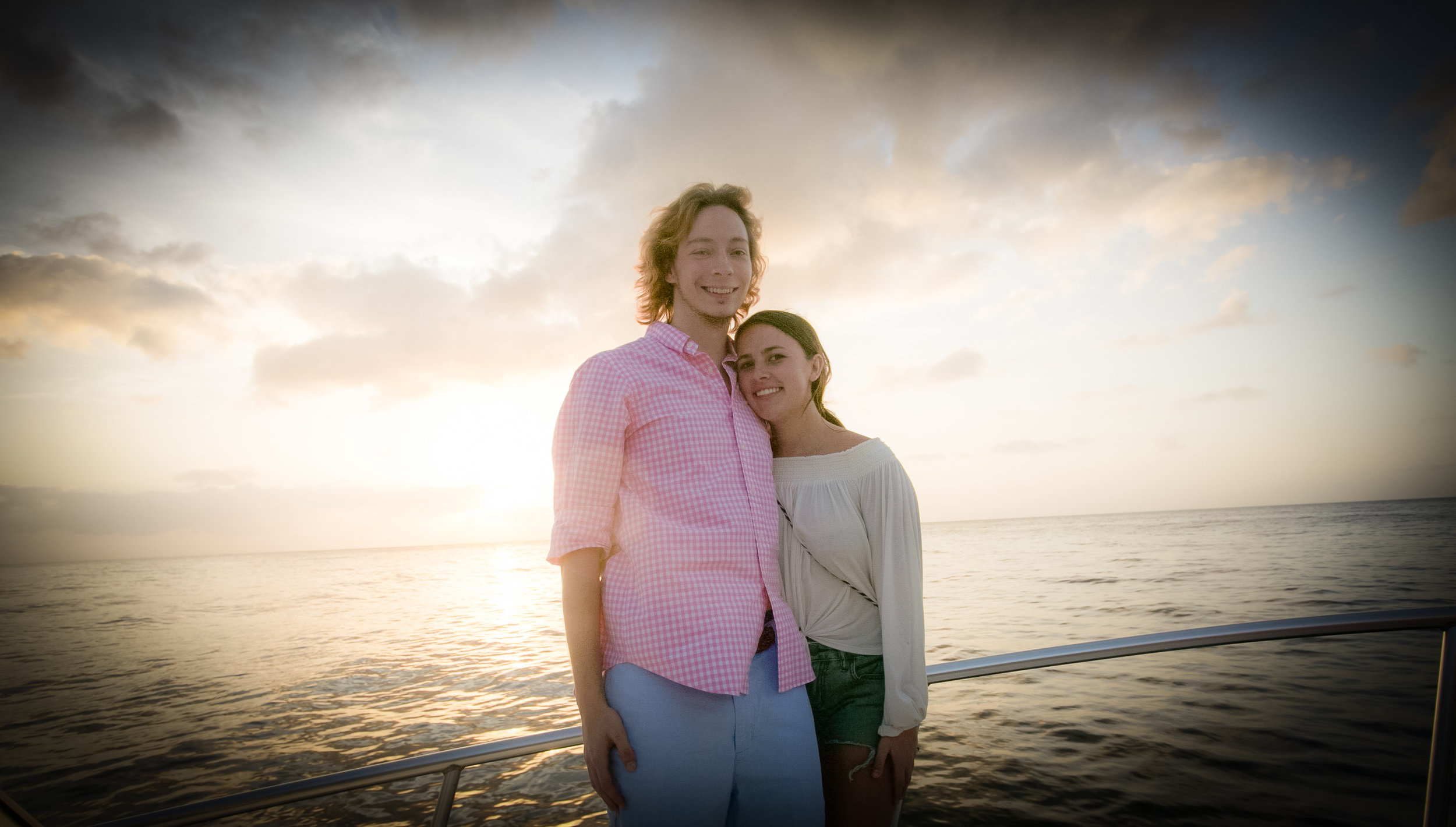 Not newly weds but enjoying vacation as well while sunset cruising and an adorable couple! Photography Courtesy of The Aisle Photography
