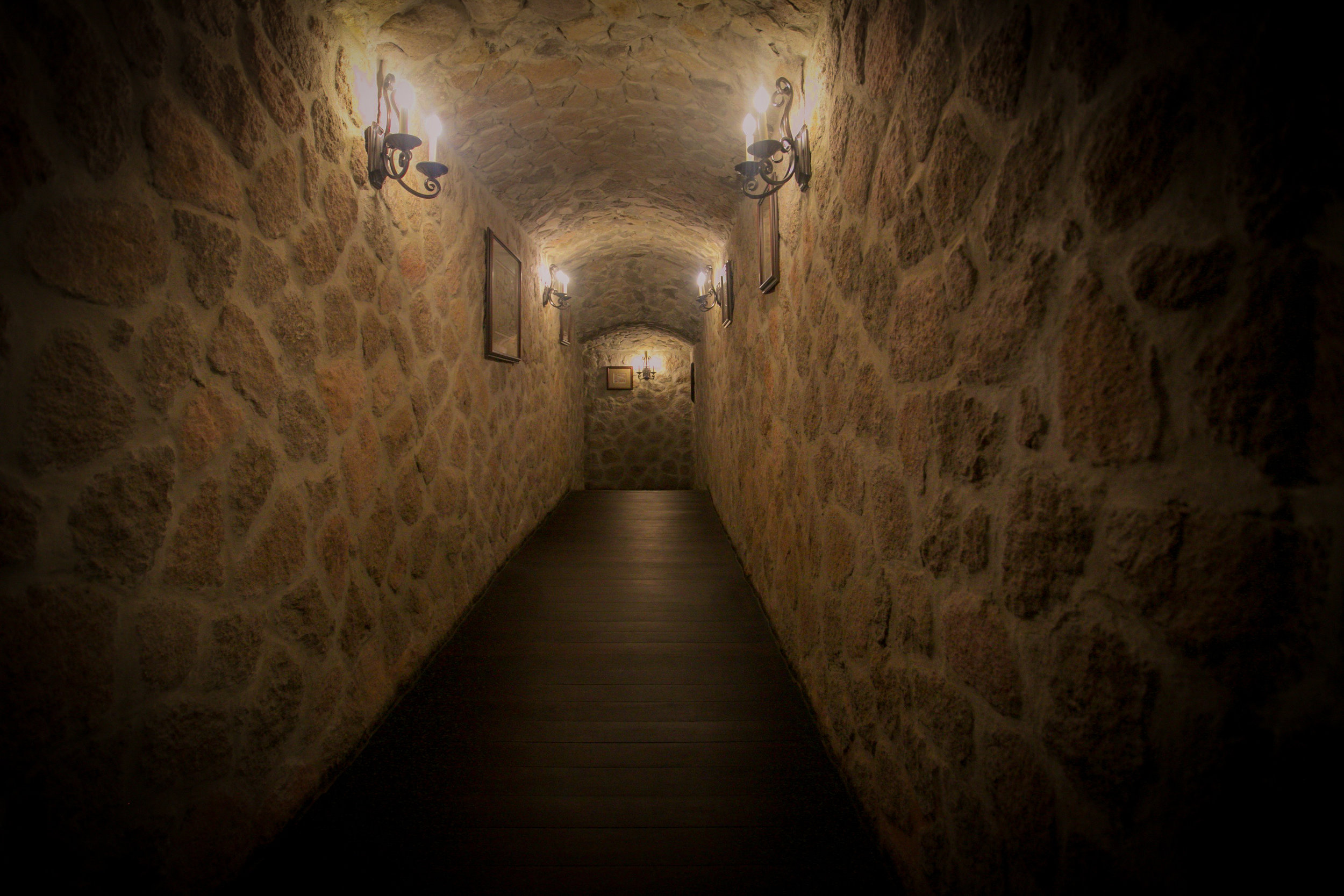 Don't forget to indulge into their underground elegantly stated wine cellar which houses 500 world renowned wines, this is the hall leading to their cellar which reminds you of a classic old world chateau. They do provide private wine and cheese pairing tastings which you can schedule during your stay. Photography Courtesy of The Aisle Photography