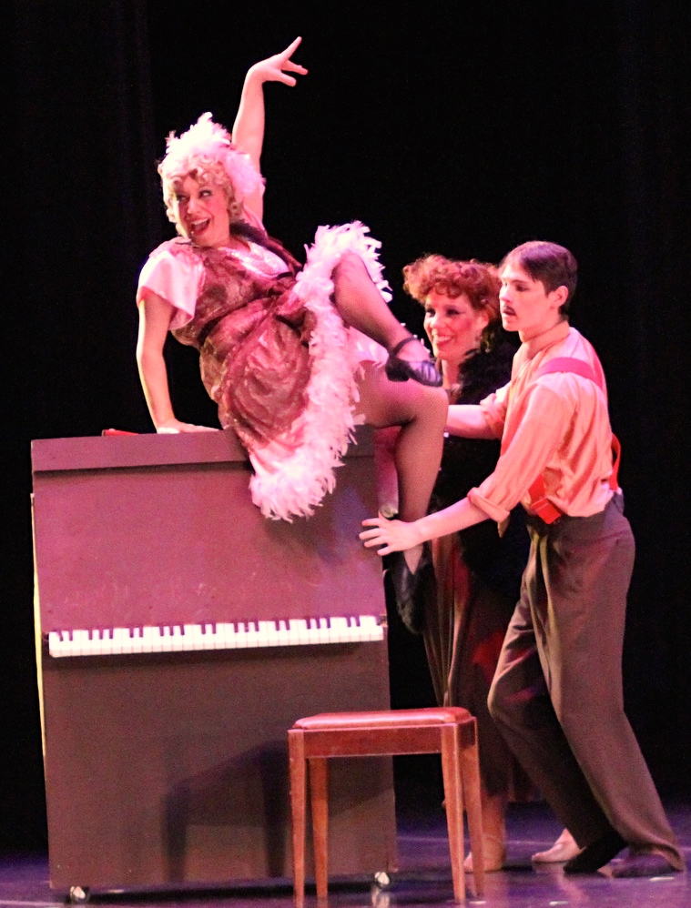 """Amber as Lily St. Regisin Out on a Limb's production of Annie,alongside fellow Company MembersSara Martinez Marcotte as Ms. Hannigan, and Gabriel Blackburn as """"Rooster"""" Hannigan."""