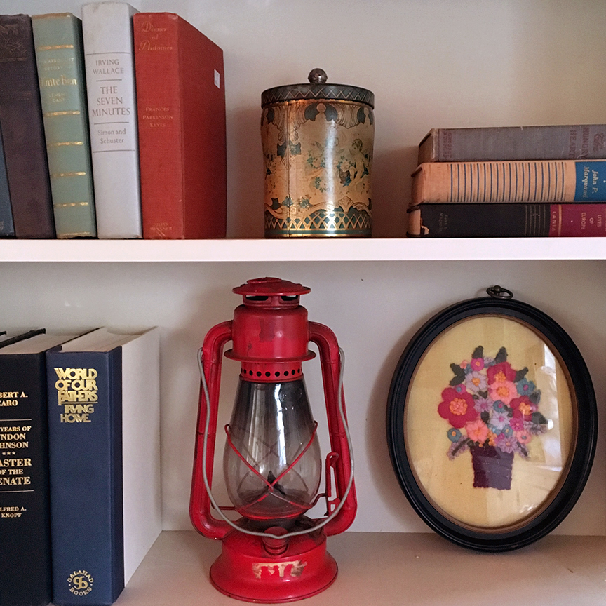 books and lantern on shelf