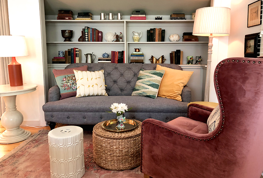 eclectic room with seating and bookshelves