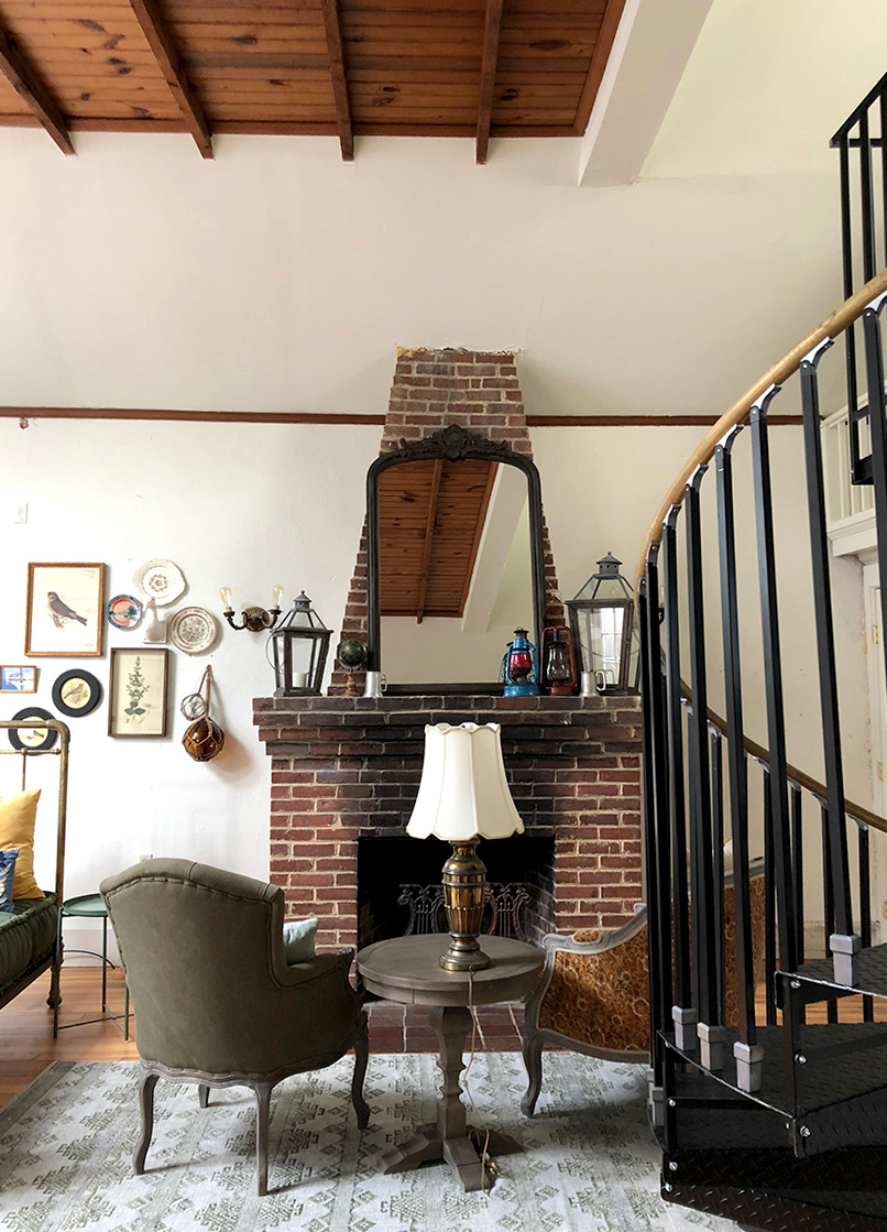 fireplace and spiral staircase