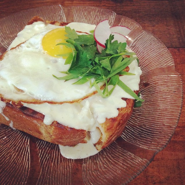 Croque madam grilled cheese with crab sauce and fries egg.