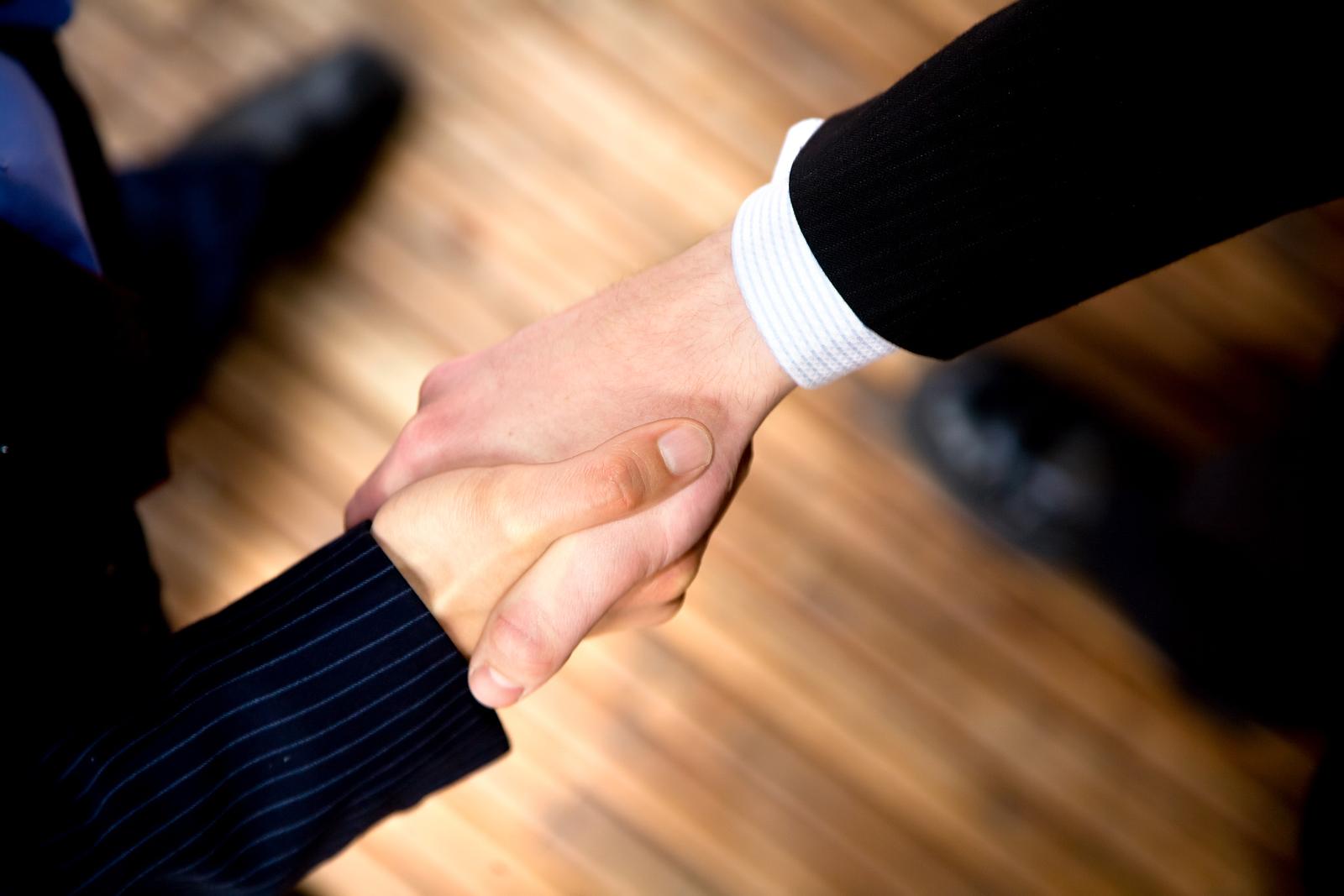 bigstock-Business-Handshake-2033677.jpg