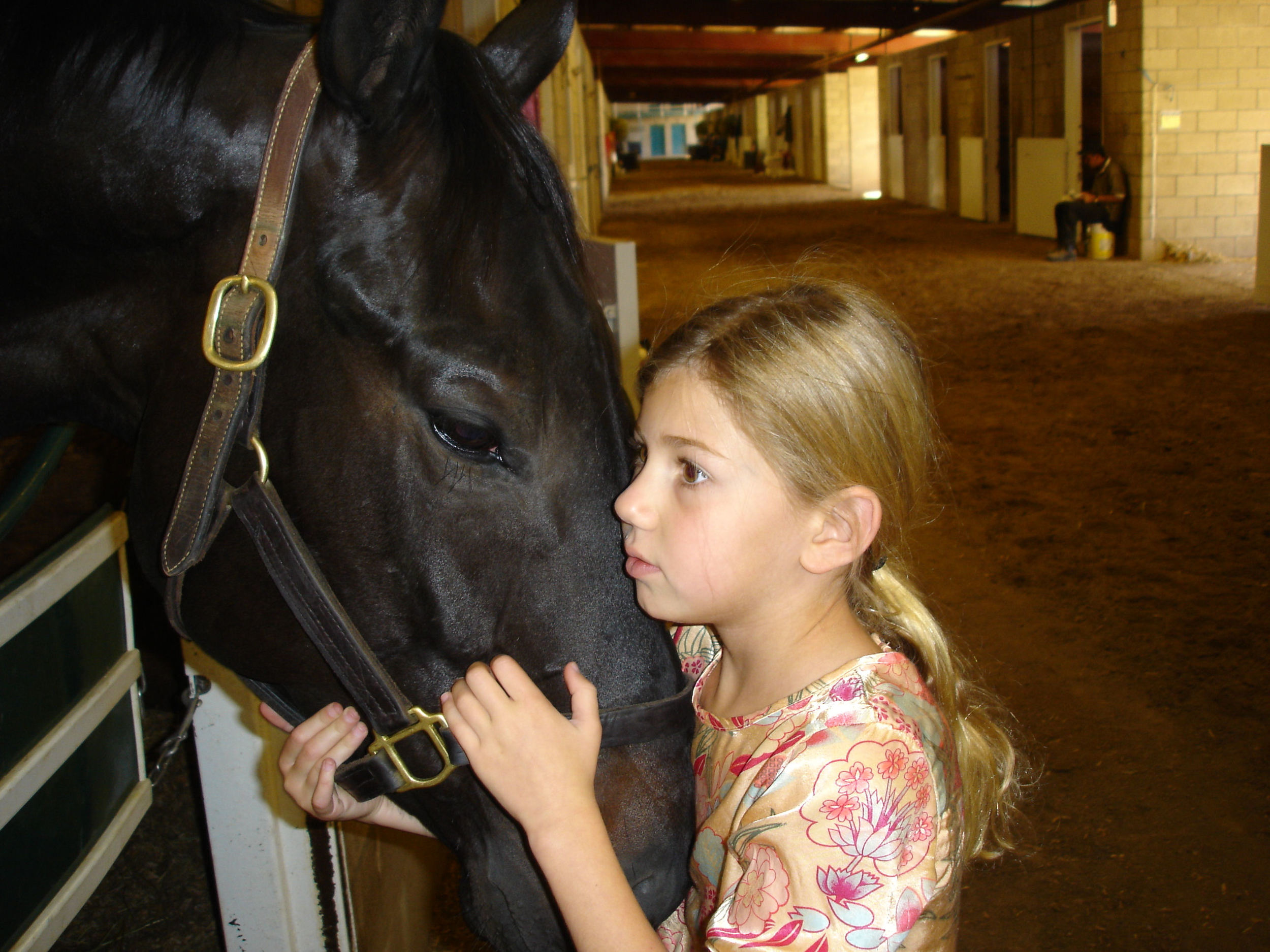 Amanda hugging Highgunner on the backside of Hollywood Park. Their eyes say it all.