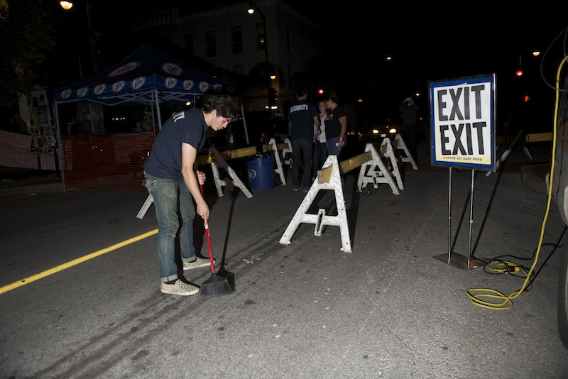 Blue Note security guard Michael Cali, sweeps around a makeshift box office during a Ninth Street Summerfest show sponsored by the Blue Note featuring Foster the People Wednesday, October 8, 2014.