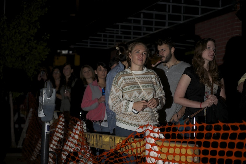 Fans stand behind a barricade on Ninth Street watching band Foster the People perform outside the Blue Note as part of Ninth Street Summerfest Wednesday, October 8, 2014.