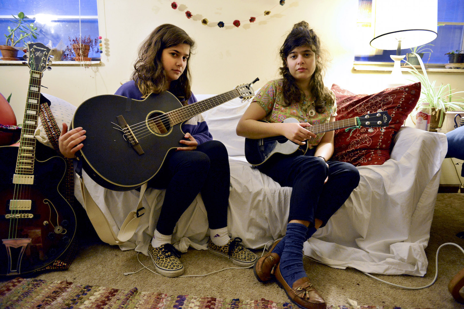 Hannah (left) and Delia Rainey (right) in their home during a Dubb Nubb band practice in Columbia, Mo. Friday, Jan. 30, 2015.