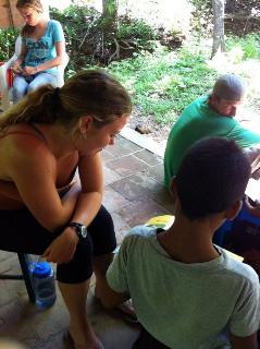"Alice's daughter, Natalie (top left), and niece, Elizabeth (bottom left), visit with children in San Juan del Sur in their most recent ""Surf 'n' Serve"" expedition to Nicaragua."