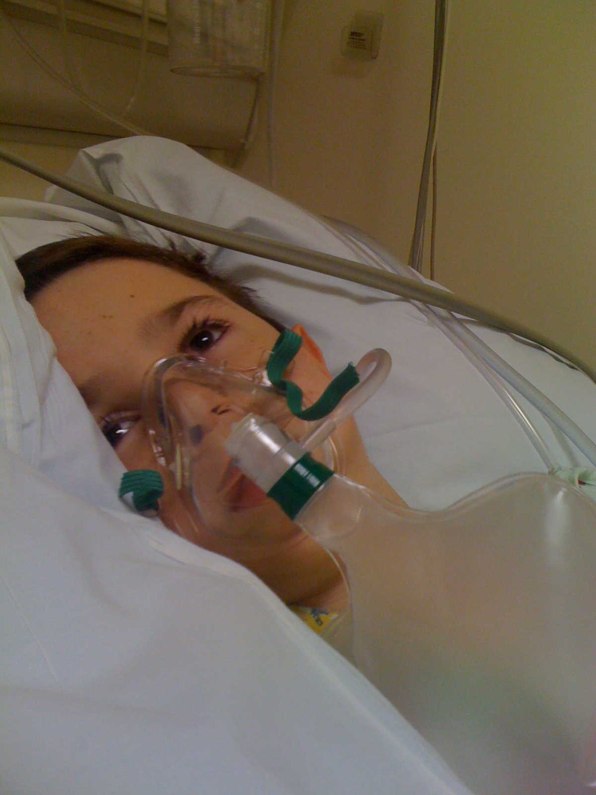 """Aidan - Alice Manning's son and inspiration for """"Stronger than the Wind"""" - lays quietly in the ER after another seizure."""
