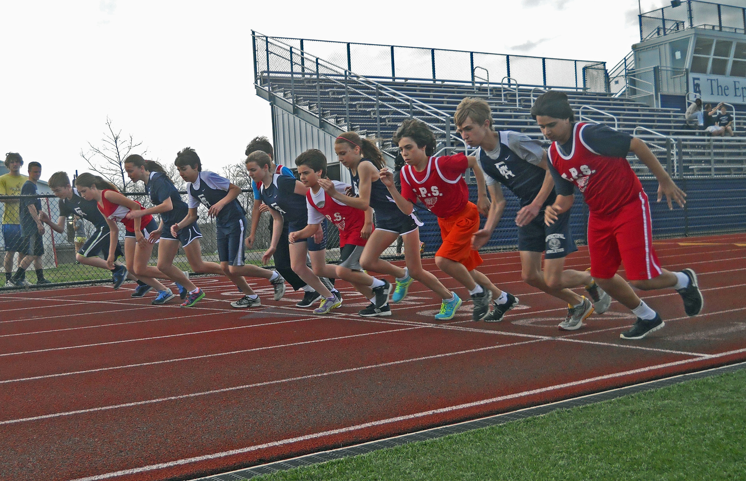 TPS track stars– in red, of course – beginning the 800-meter race at Episcopal Academy.