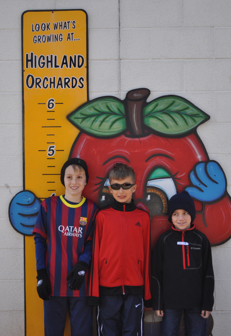 2._Orchard_trip_three_in_front_of_apple.jpg