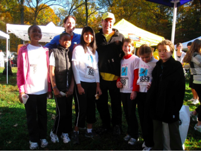 Photo: You Go Girl club director, Meg Waldron, and team pose with Jay Scott, founder of Alex's Lemonade Stand (2010).