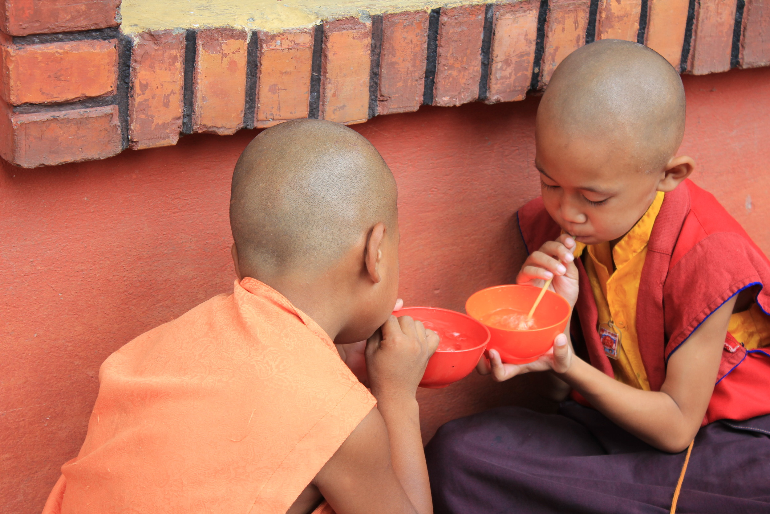 Small monks practicing circular breathing.