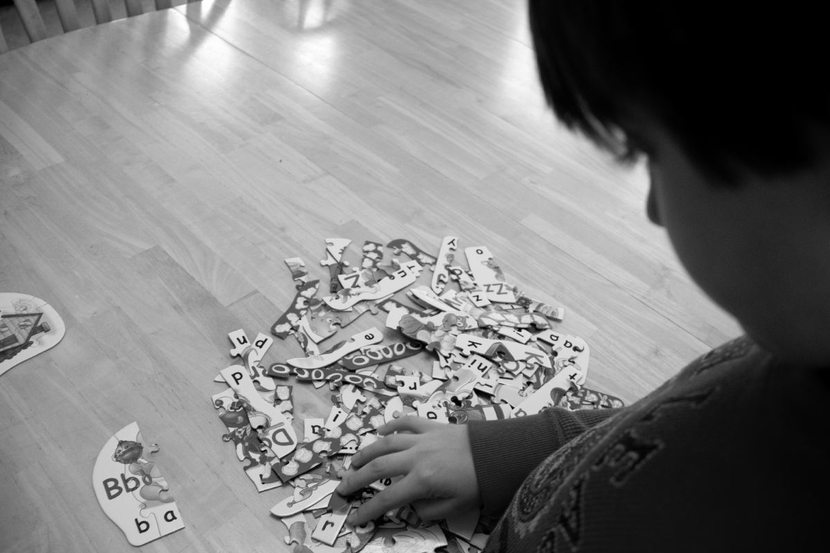 """Gavin struggles to find a missing piece of his word puzzle. """"He often can get more distracted by himself than by others around him,"""" said Helen Grace."""