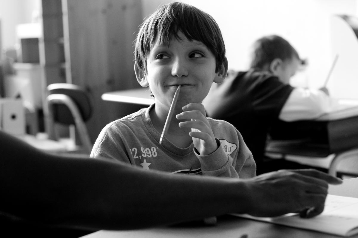 Gavin puts a pencil in his mouth to avoid starting his worksheet. Many autistic children become manipulative when teachers don't know how to work with children with special needs.