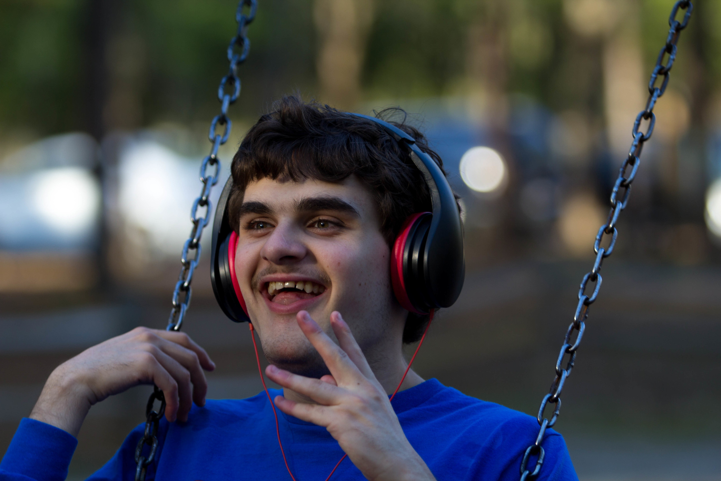 """""""I know Zack will never live alone,"""" Vicki said. """"He will either be always living with us or if he lives in a home away from us, it will be a group home. I would rather him live with us. He's my son.""""  Zack listens to children's songs while swinging at the neighborhood park."""