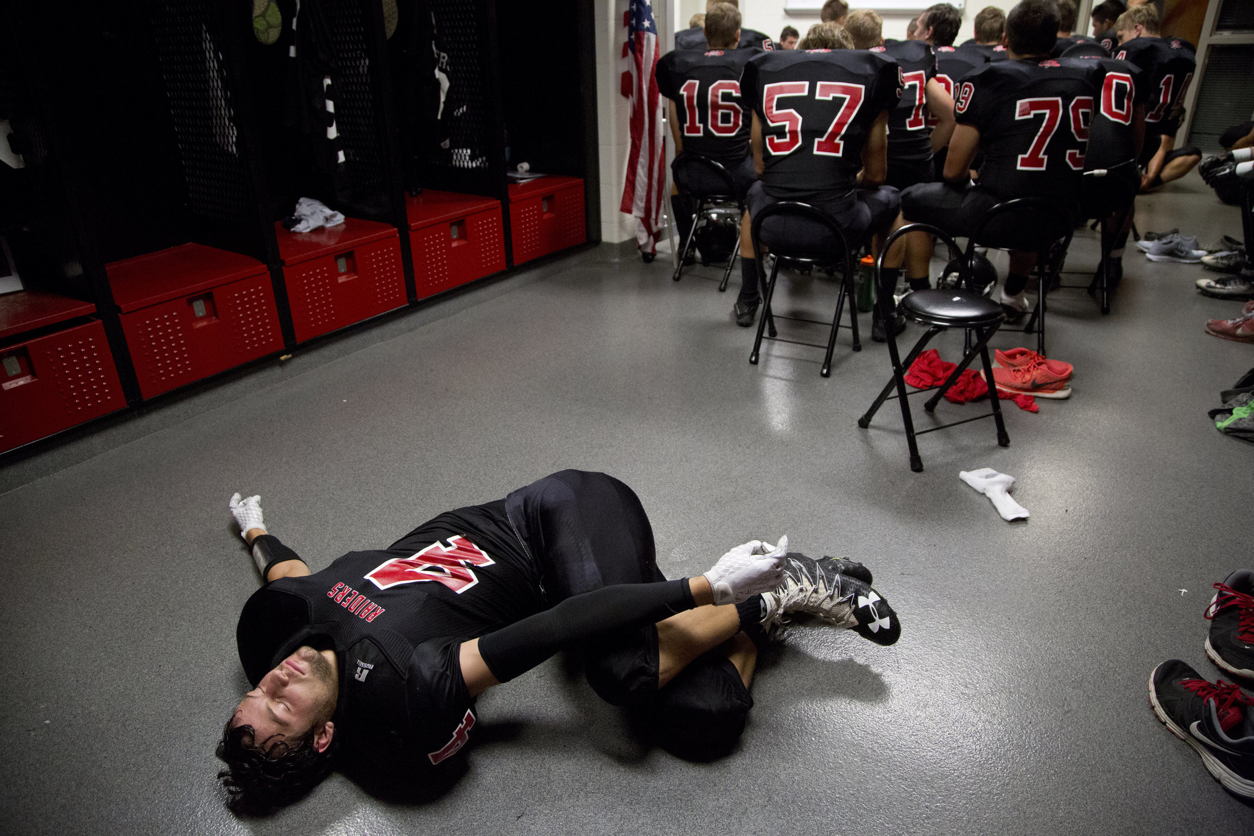 Southridge's Nolan O'Brien stretched in the locker room before the game against Corydon Central at Southridge High School in Huntingburg on Friday. The Raiders beat the Panthers 21-14.