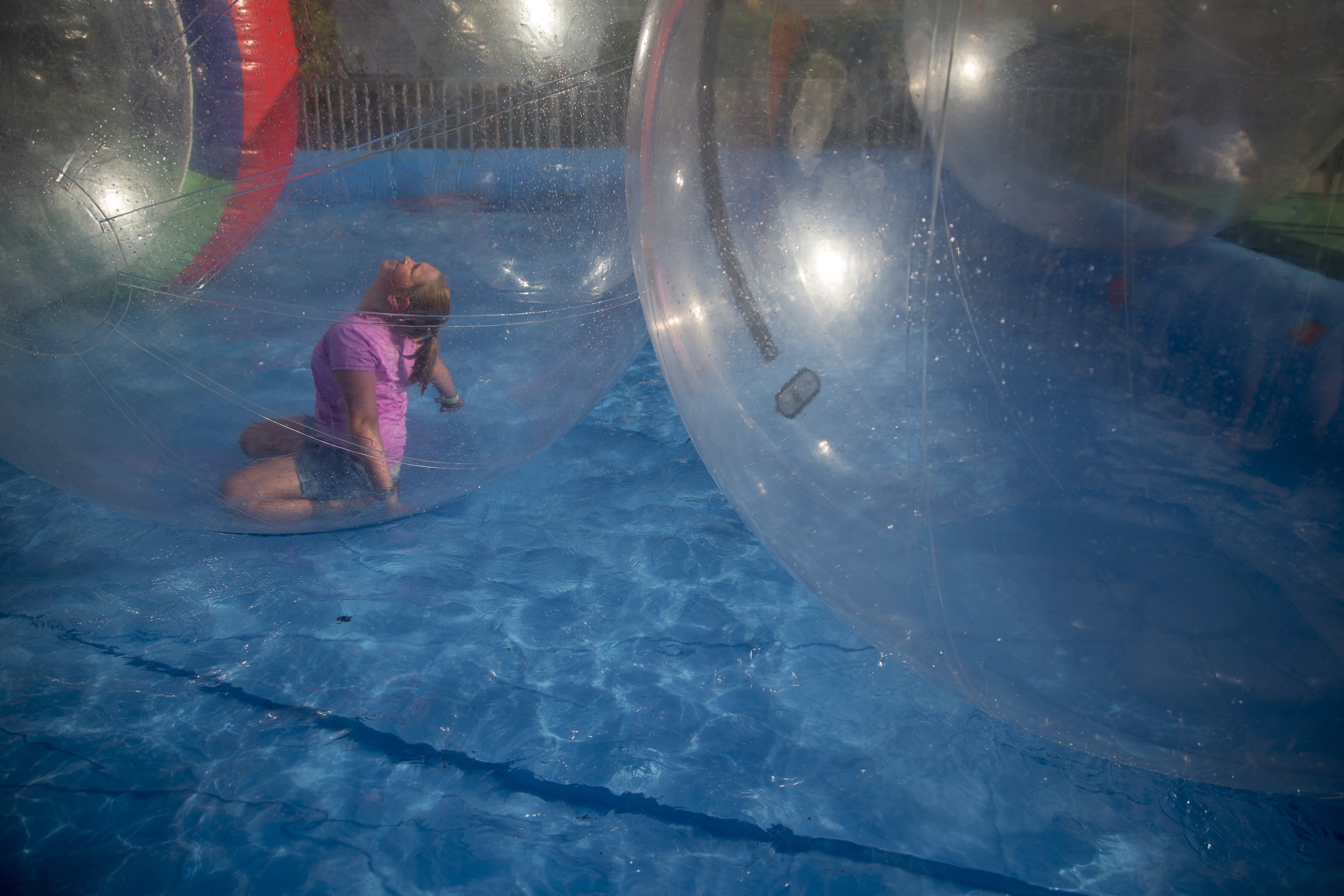 Haliey Eckert of Jasper, 9, floated around a temporary pool in a large blow up ball on Saturday evening at Strassenfest in Jasper. This ride gives kids the chance to feel like they're walking on water or floating on the surface while staying dry.