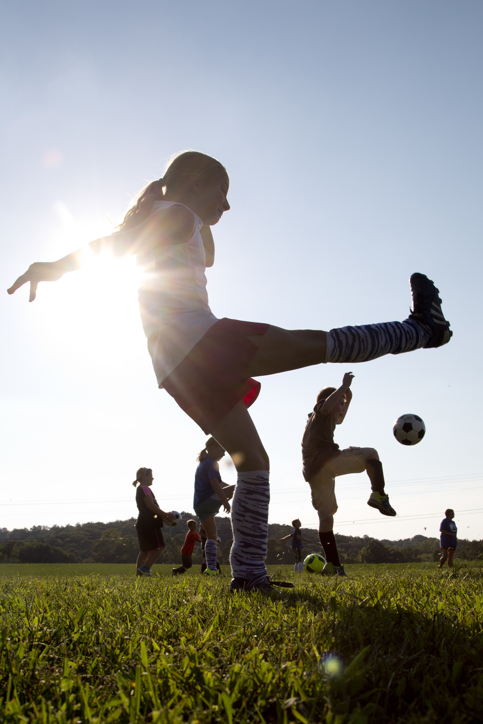 Cassidy Riecker of Celestine, 10, front center, and Elijah Kerby of Nicholson Valley, 9, right, practiced drop kicks with their Northeast Dubois Youth Soccer team, the Thunder, in Celestine on Tuesday.