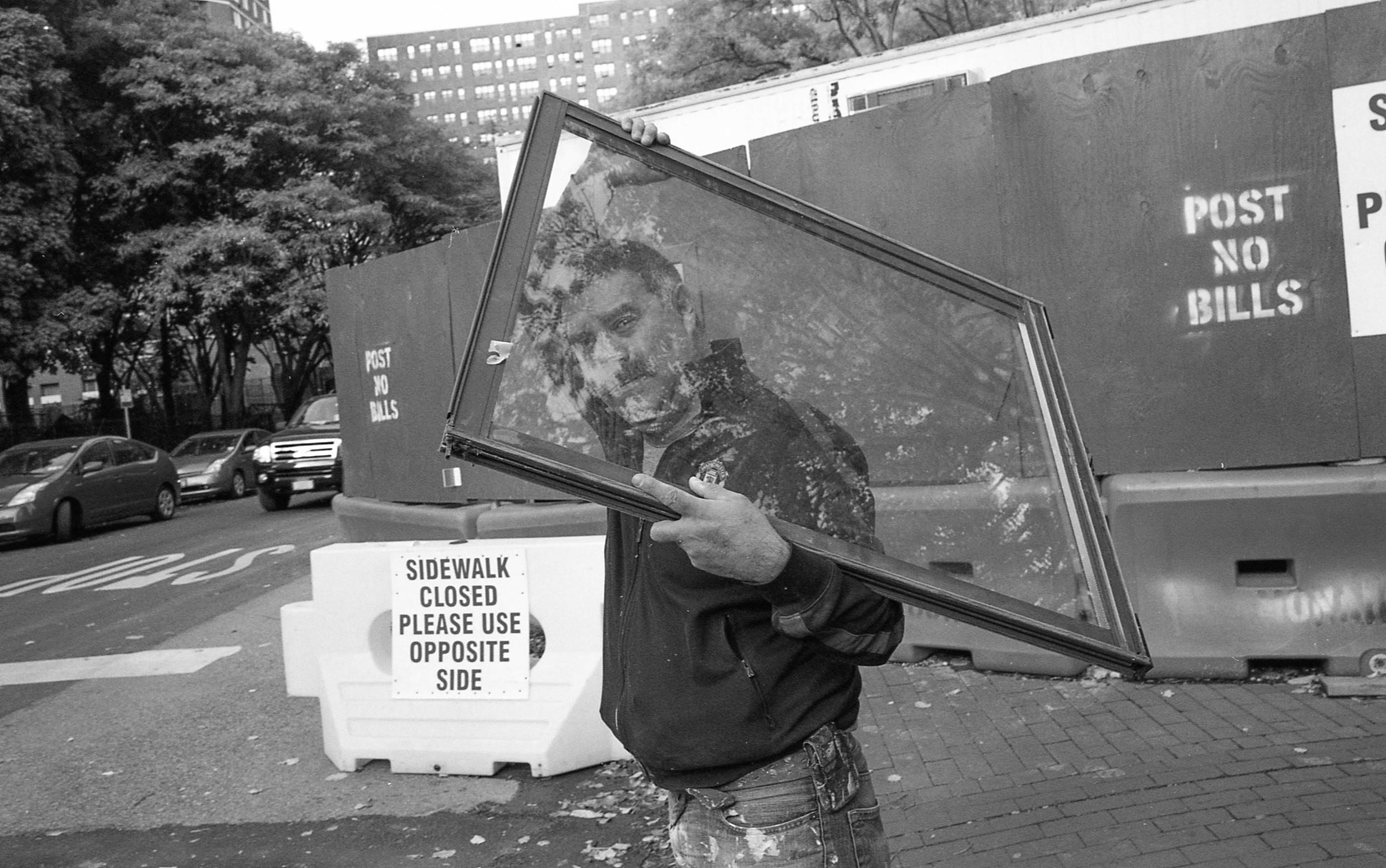man carrying a window.jpg